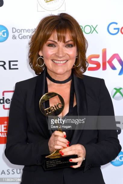 Lorraine Kelly poses with the Special Award during the 2019 'TRIC Awards' held at The Grosvenor House Hotel on March 12 2019 in London England