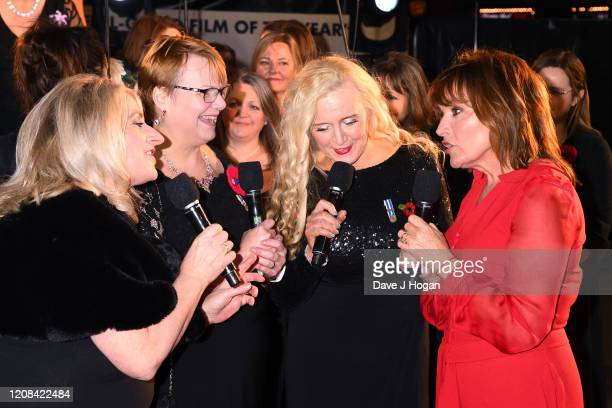 Lorraine Kelly speaks with members of the Combined Military Wives Choir during the Military Wives UK Premiere at Cineworld Leicester Square on...
