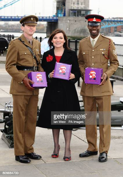 Lorraine Kelly stands Captain Tom Cardwell and Sgt Rayon Hammond as she prepares to launch the uk4u Thanks 2011 Christmas Box campaign at the Tower...