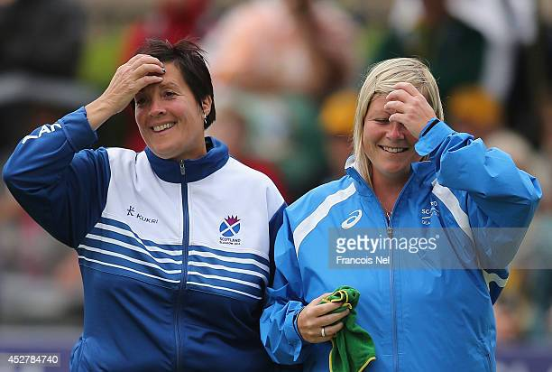 Lorraine Malloy and Claire Johnston of Scotland reacts during the Women's Fours SemiFinal match between South Africa and Scotland at Kelvingrove Lawn...