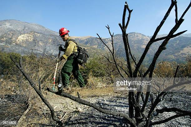 Lorraine Messmer hugs her daughter Tessa as they stand in their burnt out home October 28 2003 in Waterman Canyon California Wildfires continue to...