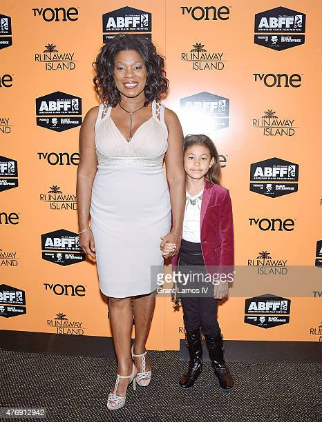 Lorraine Toussaint and her daughter Samara Grace attend the Runaway Island Premiere at the 2015 American Black Film Festival at AMC Empire on June 12...