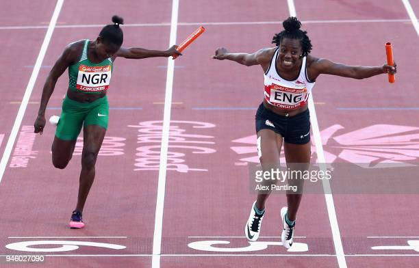 Lorraine Ugen of England crosses the line to win gold ahead of Rosemary Chukwuma of Nigeria in the Women's 4x100 metres relay final during athletics...