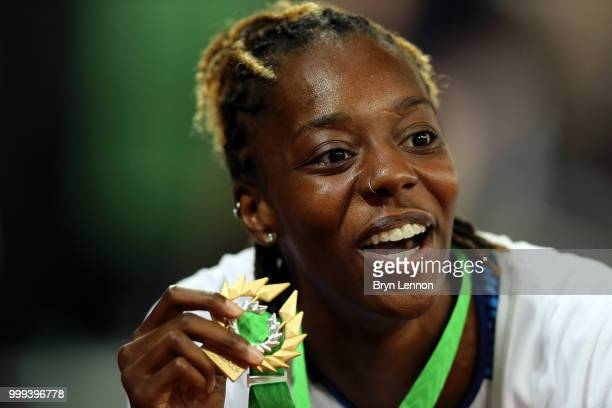 Lorraine Ugen of Great Britain celebrates with her gold medal after winning the Women's long jump at London Stadium on July 14, 2018 in London,...