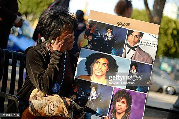 Lorraine Womble reacts during a gathering in Leimert Park in memory of musician Prince on April 21 2016 in Los Angeles California Prince died earlier...