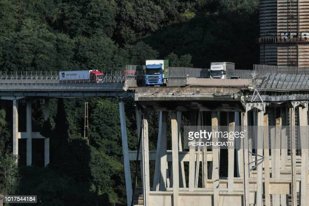 TOPSHOT Lorries abandoned by their drivers still stand on the Morandi motorway bridge three days after a section collapsed in the northwestern city...