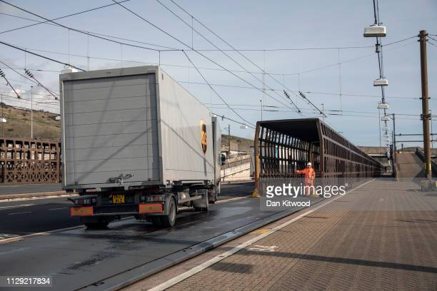 Lorries disembark the Eurotunnel train on March 8, 2019 in Folkestone, England. The Eurotunnel rail shuttle is a vital route for commercial traffic...