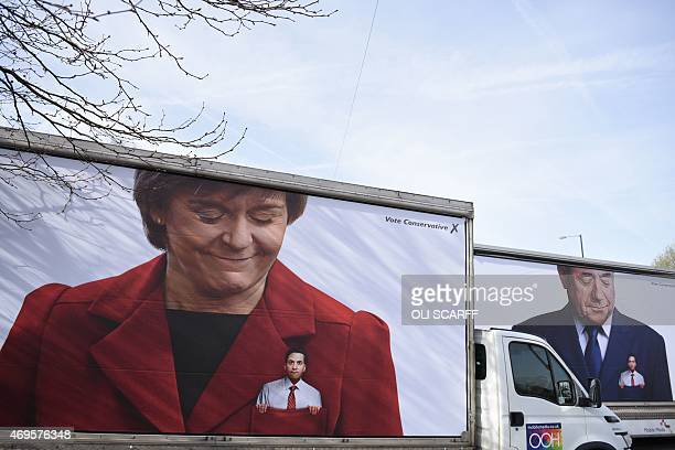 Lorries featuring Conservative Party campaign posters showing Ed Miliband leader of the opposition Labour Party with Scottish First Minister Nicola...