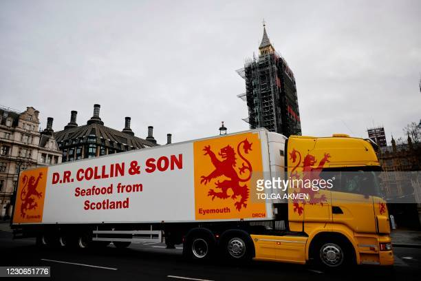 Lorries from Scottish seafood companies drive past the Houses of Parliament in a protest action by fishermen against post-Brexit red tape and...