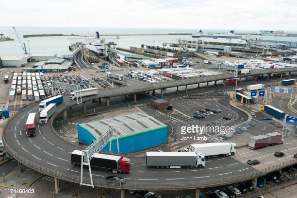 lorries leaving the port of dover in kent, england. - dover england stock pictures, royalty-free photos & images