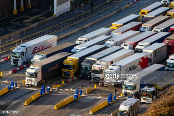Lorries line up at control barriers for departure inside the Eastern Dock of the Port of Dover is where the cross channel port is situated with...
