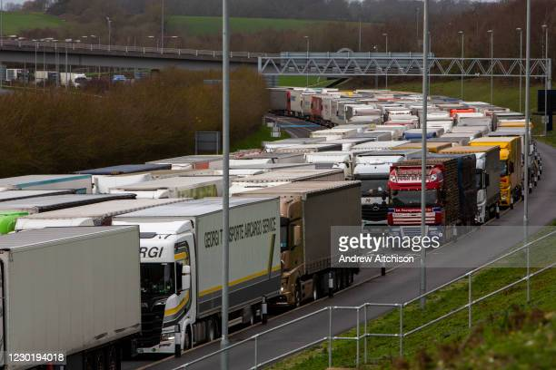 Lorries line up due to customs delays at the entrance of the Eurotunnel, Cheriton, Folkestone, Kent. United Kingdom on the 18th of December 2020. The...