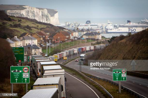 Lorries line up on the M20 motorway to use the BREXIT Dover Tap contraflow system into the Eastern Dock of the Port of Dover where the cross channel...