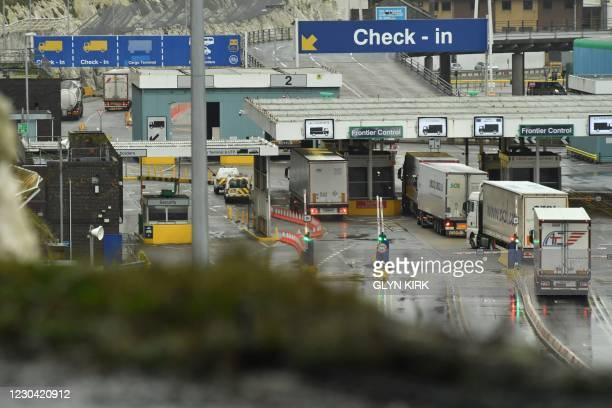 Lorries prepare to embark on a ferry at the Port of Dover, southeast England, on January 4, 2021 following Britain's departure from the European...