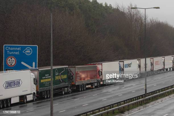 Lorries queue during operation stack on the M20 towards Dover on December 21, 2020 in Dover, England. Citing concern over a new covid-19 variant and...