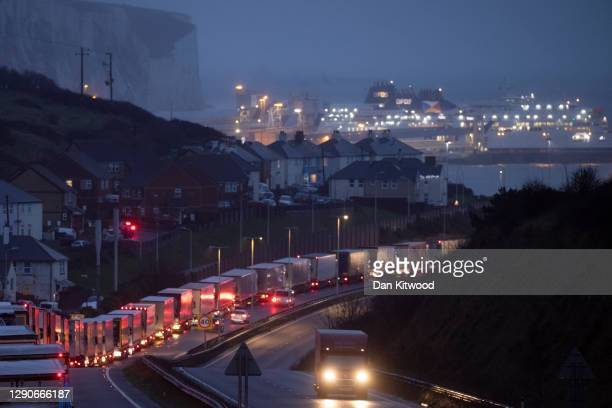 Lorries queue on the route into Dover Port to board ferries to France on December 11, 2020 in Dover, United Kingdom. The trade deal negotiations...