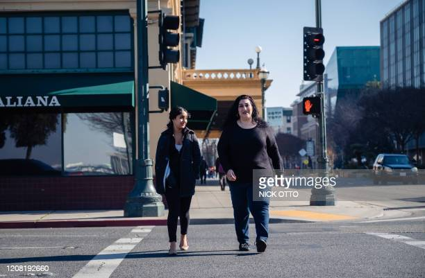 Lorrine Paradela , walks with Sukhi Samra, Executive Director of the Stockton Economic Empowerment Demonstration in Stockton, California on February...