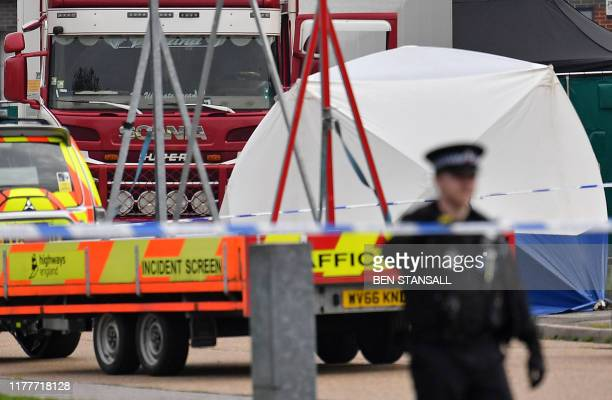 A lorry believed to have originated from Bulgaria and found to be containing 39 dead bodies is pictured inside a Police cordon after being discovered...