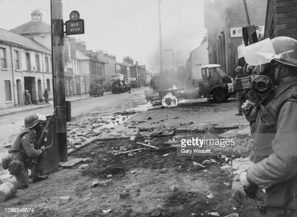 Lorry burns as British troops maintain a presence on the streets during riots in the Falls Road area of Belfast, Northern Ireland, 4th July 1970.