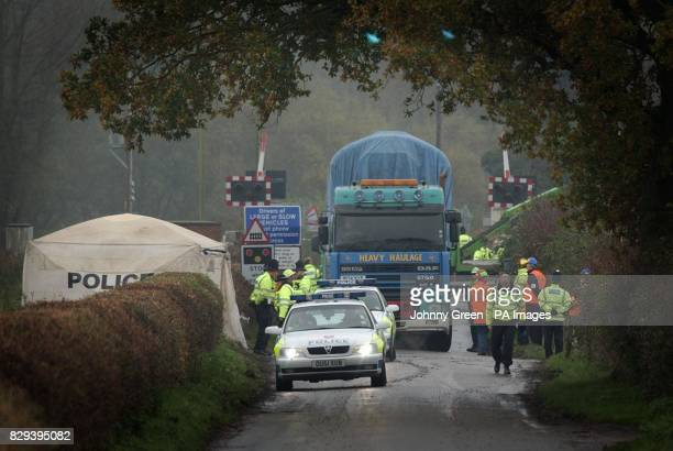 A lorry carries away part of the wreckage from last Saturday's train crash which occurred when a car came to a halt on a level crossing causing the...