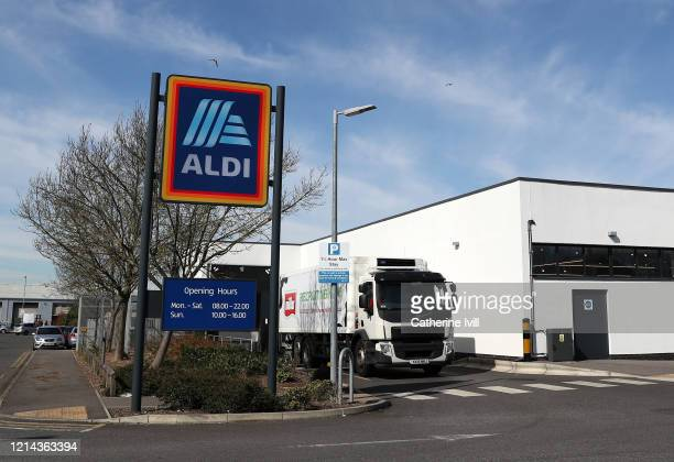A lorry delivers to an Aldi supermarket on March 23 2020 in Aylesbury England Coronavirus pandemic has spread to at least 182 countries claiming over...