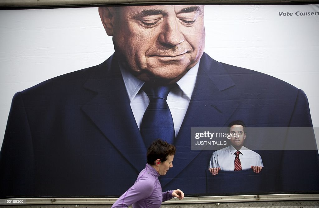A lorry displaying a Conservative party poster which pictures Labour Party Leader Ed Miliband in the pocket of former Scottish First Minister Alex Salmond parked outside the Labour Party's Spring event in Birmingham, central England on March 14, 2015. Ed Miliband, who hopes to become prime minister on May 7, urged voters to choose hope over fear at a rally for activists Saturday. Miliband is fighting Prime Minister David Cameron for the keys to Downing Street in a knife-edge race which commentators predict could result in another coalition or a minority government for Britain.