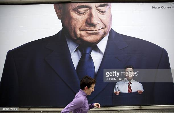 A lorry displaying a Conservative party poster which pictures Labour Party Leader Ed Miliband in the pocket of former Scottish First Minister Alex...