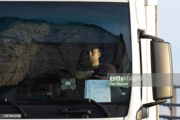 Lorry driver arrives at Dover port displaying his official negative Covid-19 test letter on January 22, 2021 in Dover, England. Since Brexit, new...