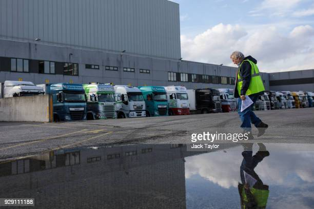 Lorry driver Bob Evans 68 makes his way to submit his paper work before loading up on goods in the port of Antwerp on March 5 2018 in Antwerp Belgium...