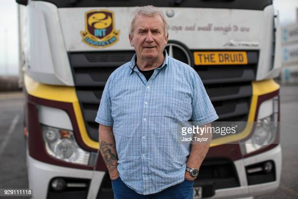 Lorry driver Bob Evans 68 poses for a photo in front of his vehicle in the port of Antwerp on March 5 2018 in Antwerp Belgium The haulage industry...