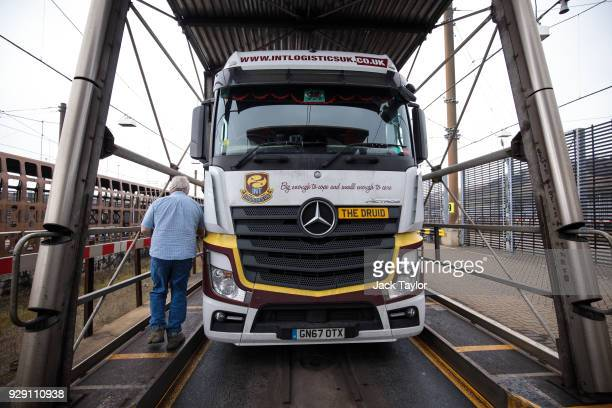 Lorry driver Bob Evans, 68 returns to his vehicle as the Eurotunnel Freight train arrives at its destination on March 6, 2018 in Folkestone, England....