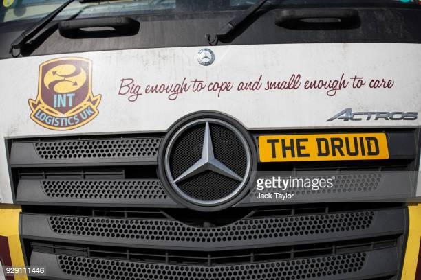 Lorry Driver Bob Evans' vehicle stands with a novelty personalised registration plate with his nickname on the front in the port of Antwerp on March...