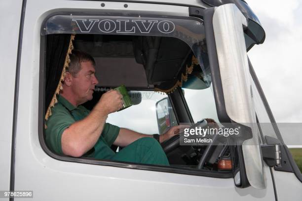 A lorry driver drinking a mug of tea whilst sitting in his cab at Bodmin Moor layby along the A30 on 23rd June 2008 in Bodmin Moor in the United...