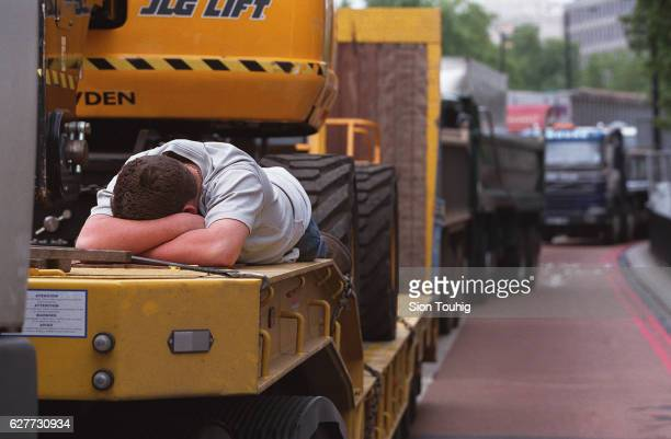 A lorry driver in the protest against high fuel prices blockade takes a restThe protest blockade has since been brokenletting fuel tankards through...
