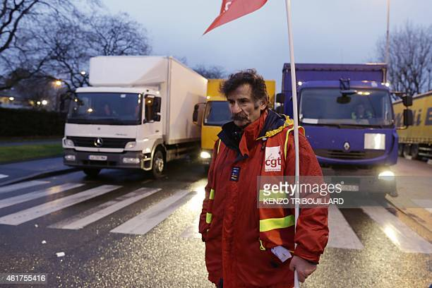 A lorry driver of the CGT union takes part in an action to block the access to the Gennevilliers port outside Paris early on January 19 at the start...