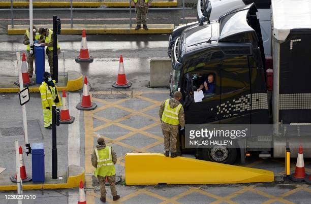 Lorry driver shows their credentials to a member of the British Army, as they enter the Port of Dover, in Dover on the south-east coast of England,...