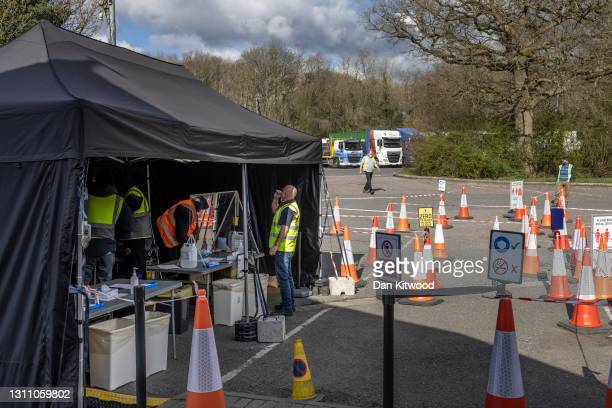 Lorry driver takes a lateral flow test while passing through a motorway service station on April 06, 2021 in Westerham, England. From today, lorry...