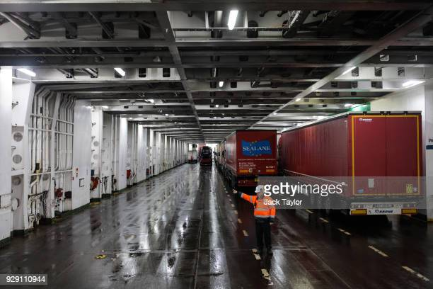 Lorry drivers are guided as they board a ferry to Calais at the port of Dover on March 5, 2018 in Dover, England. The haulage industry faces an...