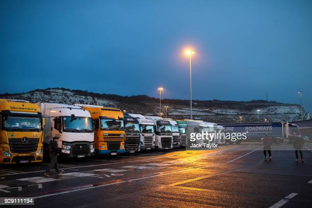Lorry drivers return to their vehicles before boarding a ferry to Calais at the port of Dover in the early hours on March 5, 2018 in Dover, England....