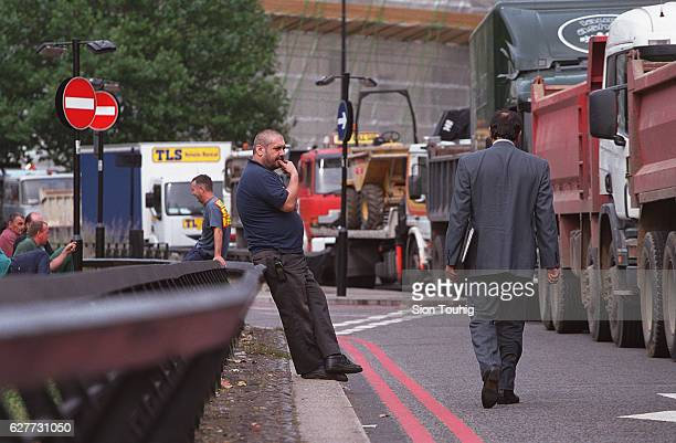 Lorry drivers take a rest from their protest blockade in Park Lane against the high fuel prices in Britain yesterdayThe blockade was broken this...