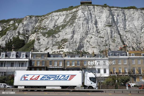 Lorry drives under the White Cliffs as it arrives at Dover Ferry Terminal on April 26, 2018 in Dover, England. After speeking to a parliamentary...