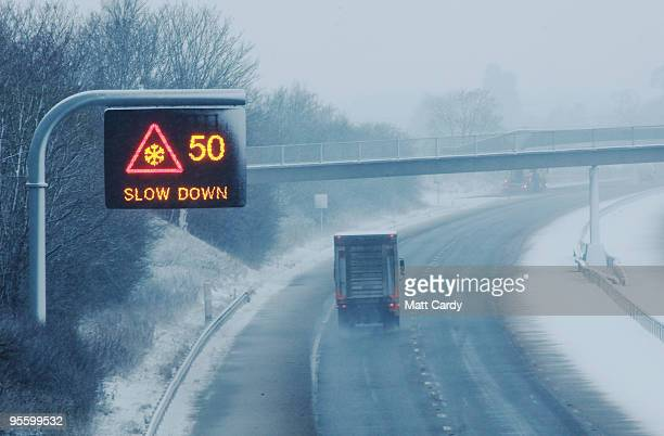 A lorry drives up the near deserted M4 motorway near the Leigh Delamere services during what would normally be peak commute time on January 6 2010 in...