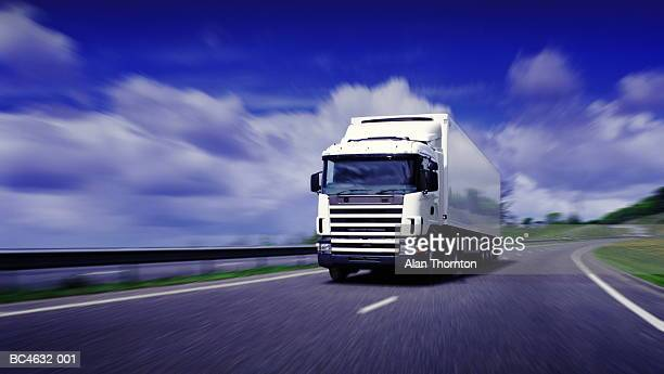 lorry driving on motorway (digital enhancement) - transportation stock pictures, royalty-free photos & images