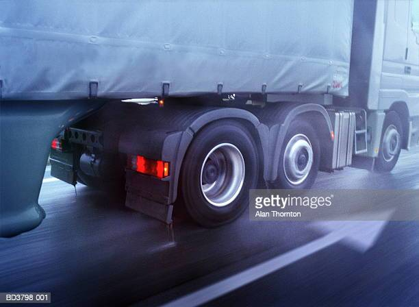 lorry driving on wet road, low section, close-up (blurred motion) - tipo di trasporto foto e immagini stock