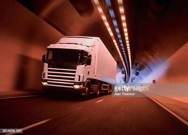 lorry driving through tunnel, cars in background (digital enhancement) - transport stock pictures, royalty-free photos & images