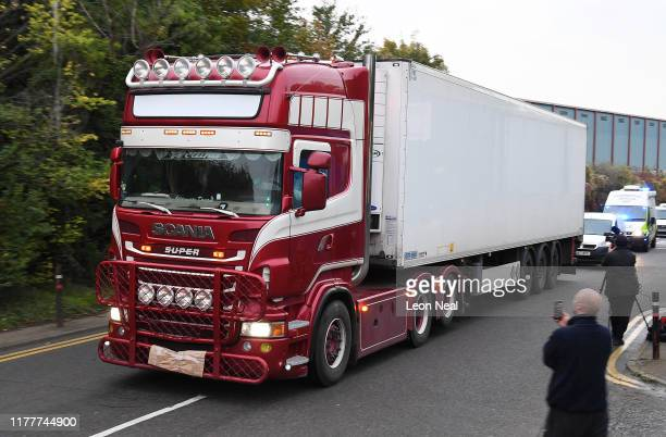 Lorry in which 39 bodies were discovered in the trailer is driven from the site to a secure location where further forensic investigation can take...