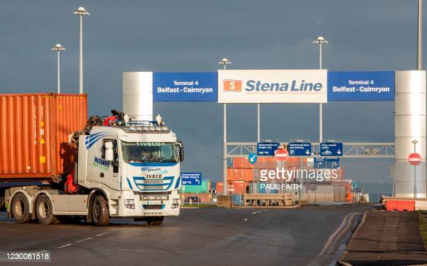 Lorry leaves the docks area in Belfast Harbour in Northern Ireland on December 10, 2020. - The port is Northern Ireland's main maritime gateway, and...