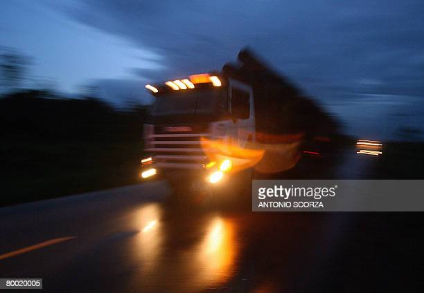 A lorry loaded with trunks runs along a road 150 Km from Tailandia in Para northen Brazil on February 26 2008 The Brazilian government started a big...