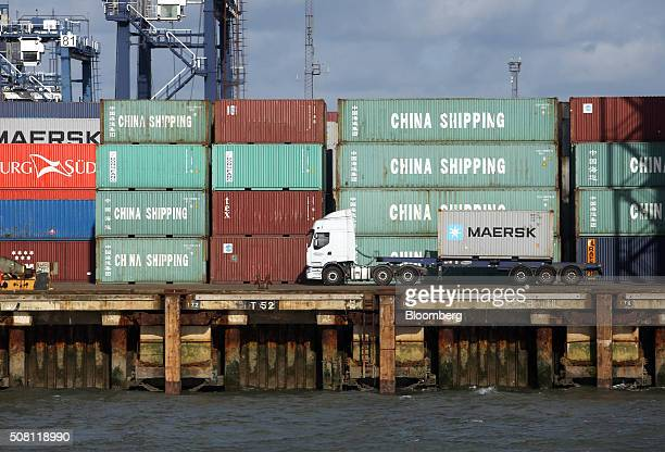 A lorry moves an AP MoellerMaersk A/S shipping container at the Port of Felixstowe Ltd a subsidiary of CK Hutchison Holdings Ltd in Felixstowe UK on...