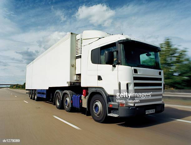 Lorry Moving Along a Motorway, Immingham, Humberside, UK
